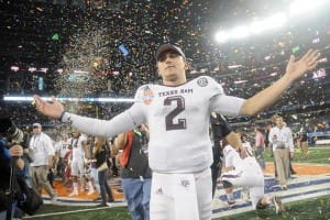 It has been a busy year for Manziel, which included a big win over Oklahoma in last year's Cotton Bowl. (Jackson Laizure/Getty Images)