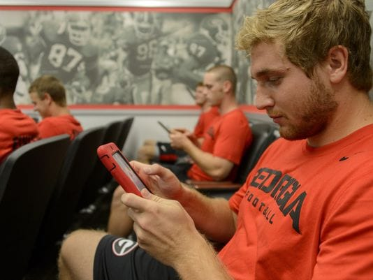 Georgia's Greg Mulkey uses an iPad during a meeting of tight ends. (Photo: Michael A. Schwarz, USA TODAY)