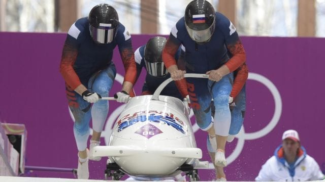 Feb 23, 2014; Krasnaya Polyana, RUSSIA; Team RUS 2 piloted by Alexander Kasjanov and teammates Ilvir Huzin, Maxim Belugin and Alexsei Pushkarev on the final run in the 4-man bobsled during the Sochi 2014 Olympic Winter Games at Sanki Sliding Center. Mandatory Credit: John David Mercer-USA TODAY Sports