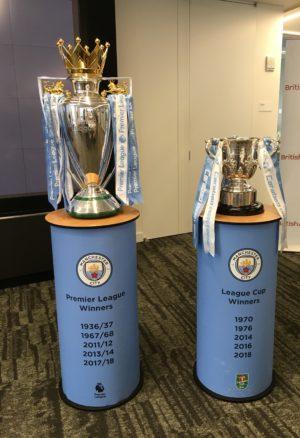 Manchester City's Premier League and League Cup trophies.
