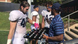 Virginia linebacker C.J. Stalker picks out his mouth guard.
