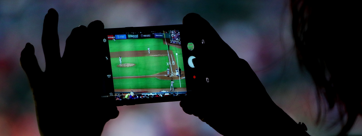 View of baseball game on mobile phone.
