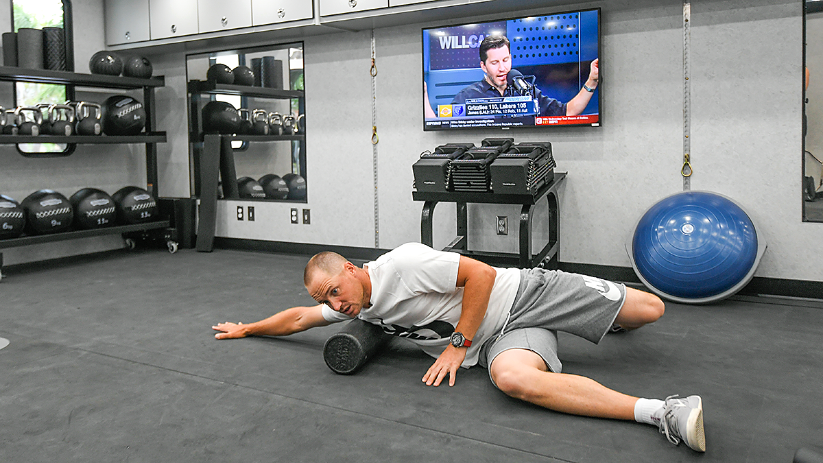 Alex Noren uses a foam roller in the mobile gym. (Photo courtesy of PGA Tour Images)
